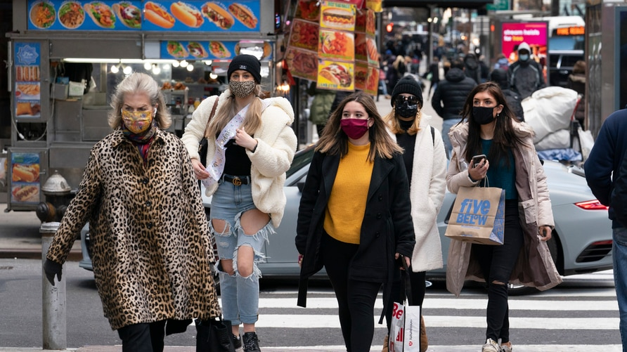 Women carry shopping bags, Thursday, Dec. 10, 2020, in New York. The spread of COVID-19 vaccines will power a stronger global…