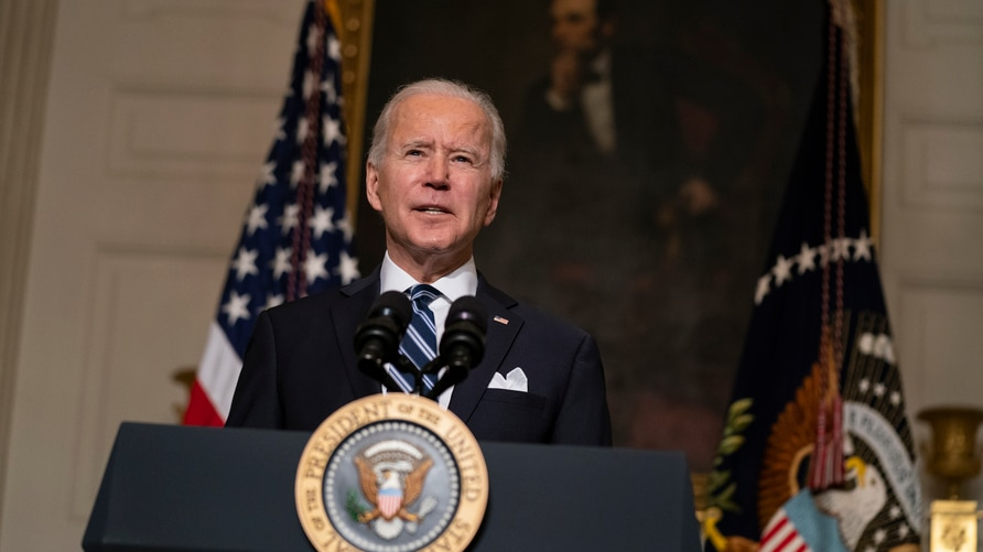 President Joe Biden delivers remarks on climate change and green jobs, in the State Dining Room of the White House, Wednesday,…