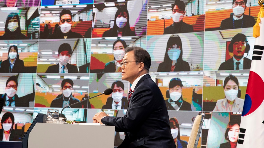 South Korean President Moon Jae-in speaks during an on-line New Year press conference with local and foreign journalists at the…