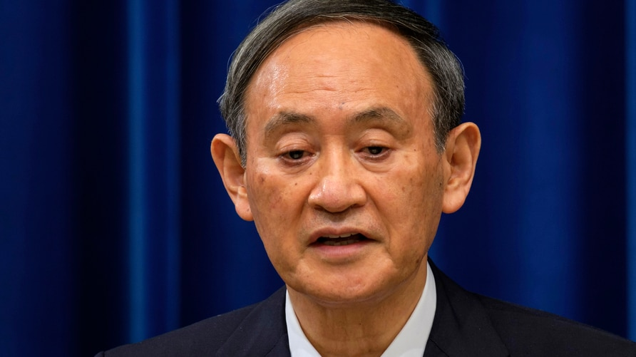 Japan's Prime Minister Yoshihide Suga delivers a speech during a press conference on the COVID-19 situation in Japan at the…