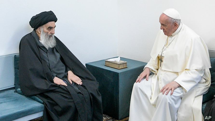 Pope Francis, right, meets with Iraq's leading Shiite cleric, Grand Ayatollah Ali al-Sistani in Najaf, Iraq, Saturday, March 6,…