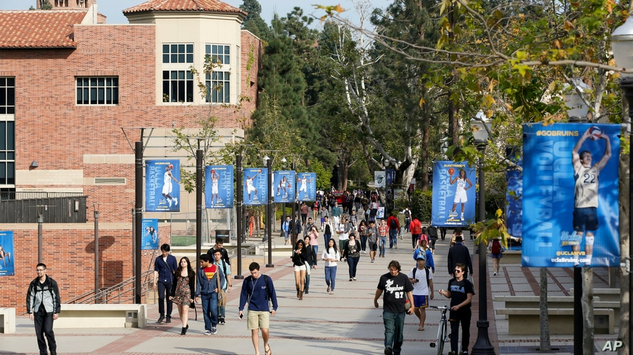 FILE - In this Feb. 26, 2015, file photo, students walk on the University of California, Los Angeles campus. A UCLA professor…