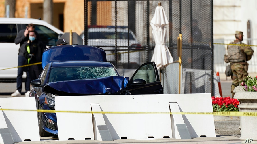 The car that crashed into a barrier on Capitol Hill is seen near the Senate side of the U.S. Capitol in Washington, Friday,…
