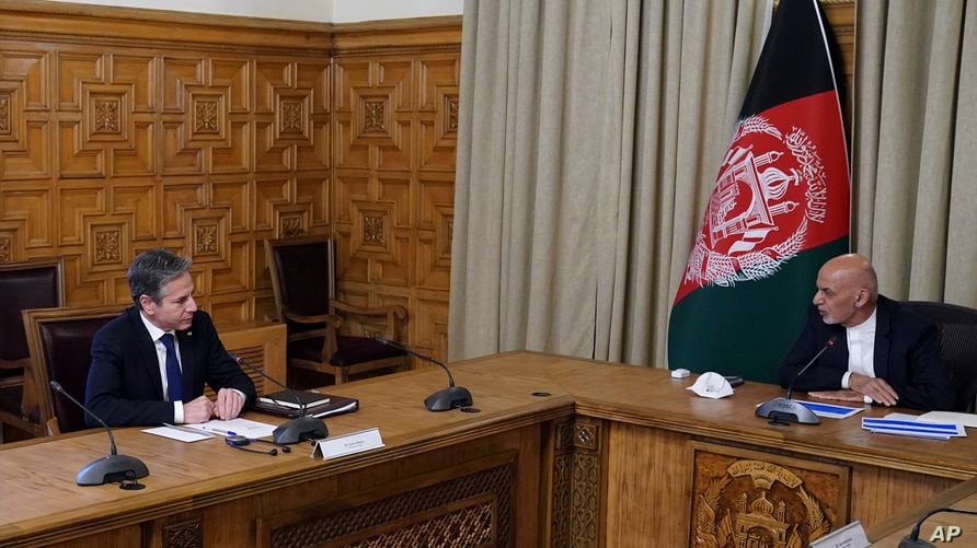 Afghan President Ashraf Ghani, right, meets with U.S. Secretary of State Antony Blinken and their delegations, at the…