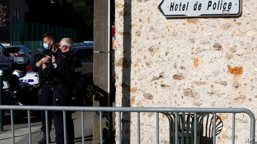 Police officers block the access next to the Police station in Rambouillet, south west of Paris, Friday, April 23, 2021. A…