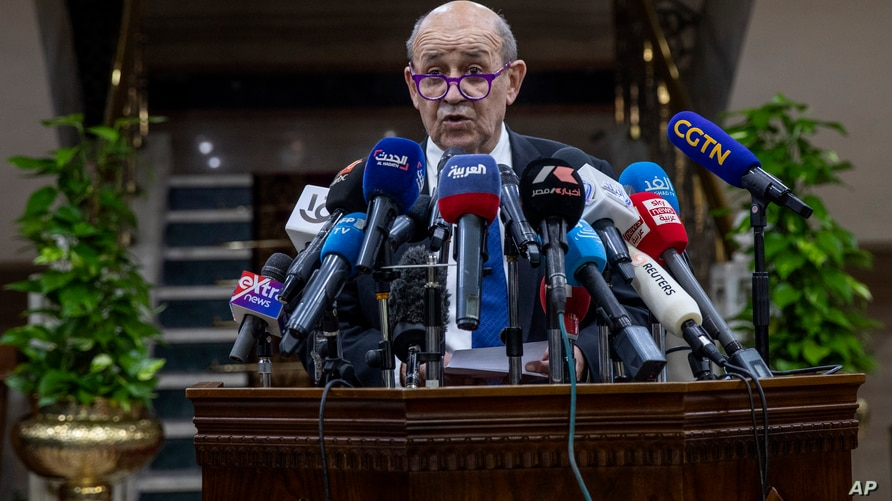 French Foreign Minister Jean-Yves Le Drian speaks during a press conference after a meeting with Muslim Grand Imam, Sheikh…