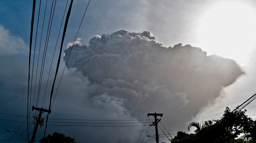 Ash rises into the air as La Soufriere volcano erupts on the eastern Caribbean island of St. Vincent, seen from Chateaubelair,…