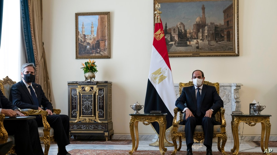 Secretary of State Antony Blinken, left, is seated during a meeting with Egyptian President Abdel Fattah el-Sissi at the…