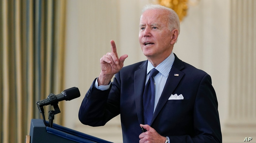 President Joe Biden takes questions from reporters as he speaks about the COVID-19 vaccination program, in the State Dining…
