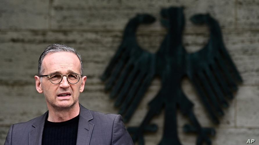 German Foreign Minister Heiko Maas addresses the media during a statement at the Foreign Ministry in Berlin, Germany, Friday,…