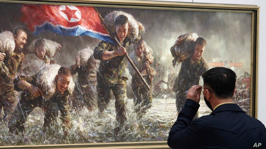 A visitor views a dramatic nationalist painting at the National New Fine Art Talents Exhibition at the Okryu Exhibition Hall in…
