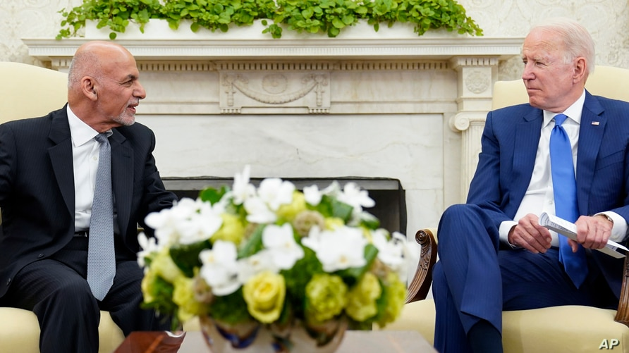 President Joe Biden, right, meets with Afghan President Ashraf Ghani, left, in the Oval Office of the White House in Washington…