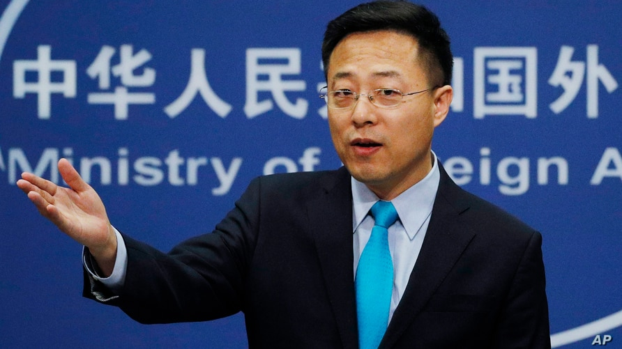 FILE - In this Feb. 24, 2020, file photo, Chinese Foreign Ministry spokesman Zhao Lijian speaks during a daily briefing at the…
