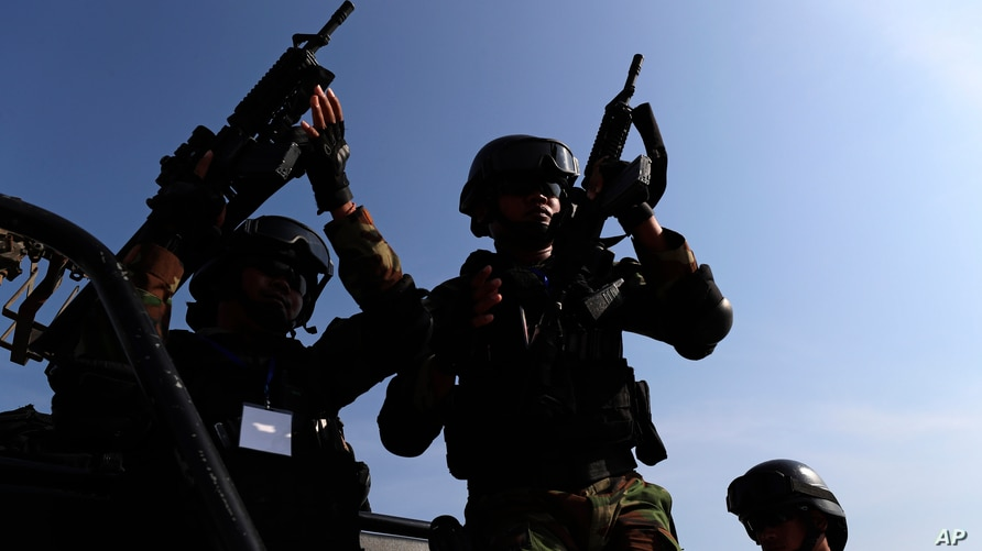 Cambodian military officers sitting on a pickup guard during a hostage-drill at Cambodia Airforce near Phnom Penh, Cambodia,…