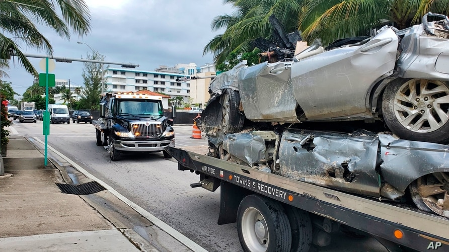 Vehicles that were pulled from the rubble of the Champlain Towers South are transported on Saturday,  July 10, 2021 in Surfside…
