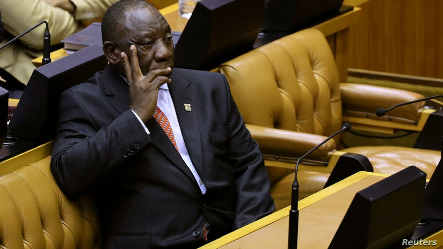 FILE PHOTO: South African President Cyril Ramaphosa waits to deliver his State of the Nation address at parliament in Cape Town