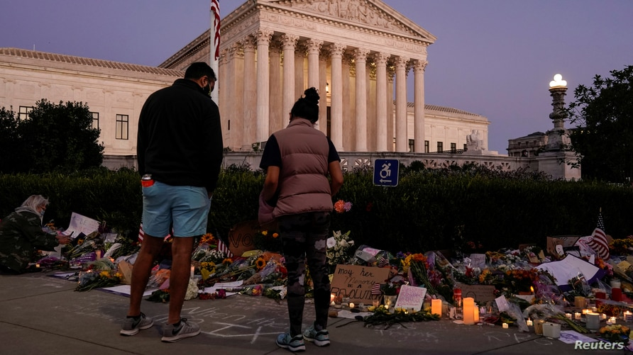 People gather to mourn the death of Associate Justice Ruth Bader Ginsburg at the Supreme Court in Washington