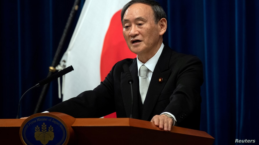 FILE PHOTO: FILE PHOTO: Yoshihide Suga speaks during a news conference following his confirmation as Prime Minister of Japan in Tokyo