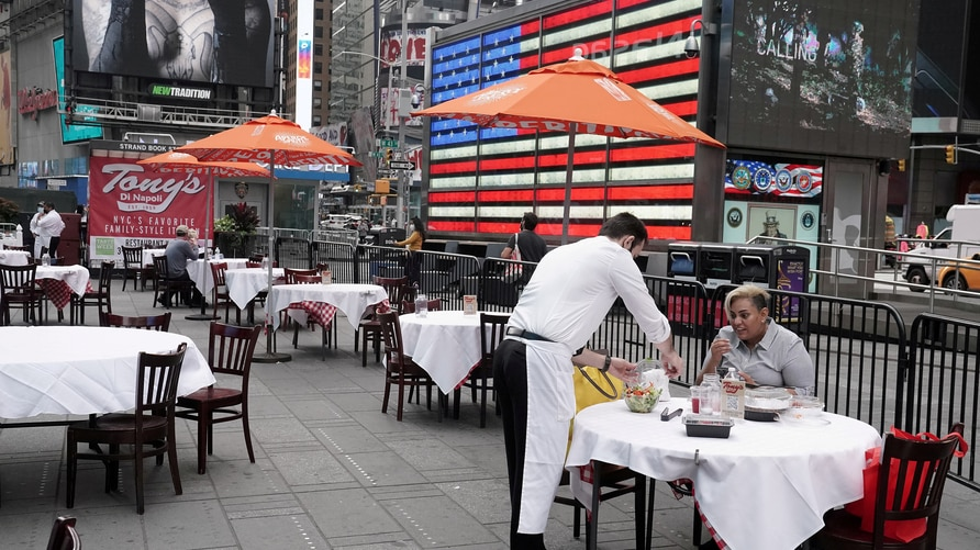 FILE PHOTO: FILE PHOTO: FILE PHOTO: Servers package food at a table at a pop up restaurant set up in Times Square in New York