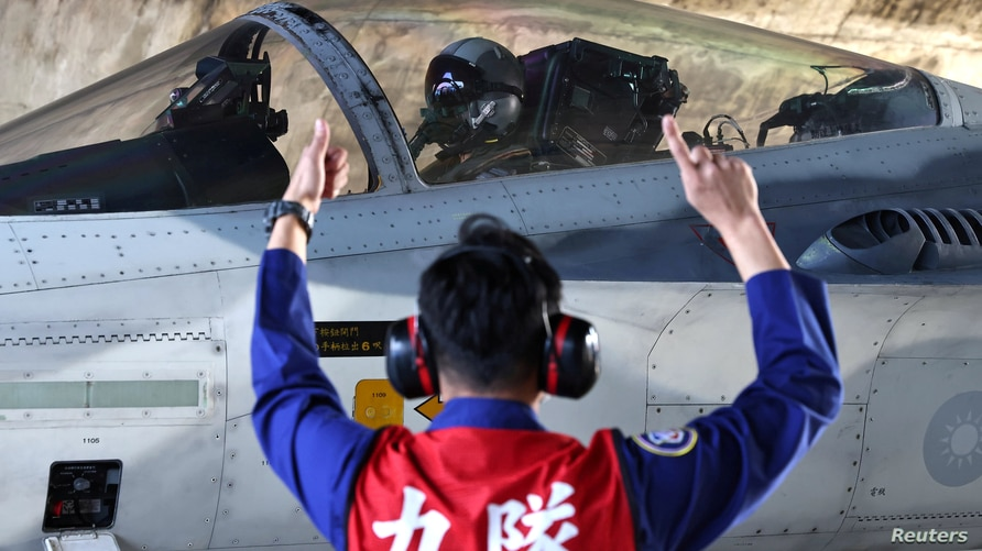 FILE PHOTO: A pilot prepares to take off on a F-CK-1 Ching-kuo IDF at an Air Force base in Tainan