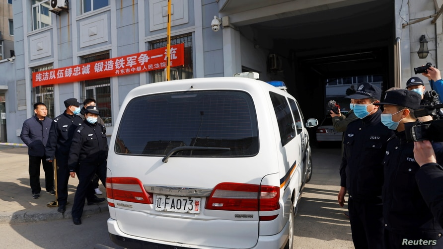 A police vehicle believed to be carrying Michael Spavor, a Canadian detained by China in December 2018 on suspicion of espionage, arrives at Intermediate People's Court, where Spavor is expected to stand trial, in Dandong