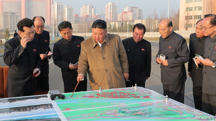 North Korean leader Kim Jong-un inspects a site on which riverside terraced houses will be erected around the Pothong Gate in Pyongyang