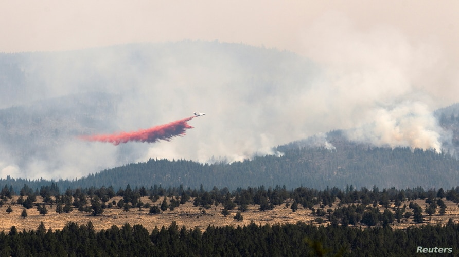 Firefighters deal with extreme conditions as Bootleg Fire expands, in Oregon