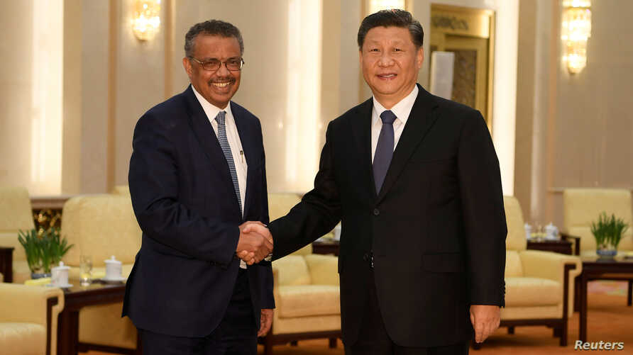 Tedros Adhanom, director general of the World Health Organization, shakes hands with Chinese President Xi jinping before a…