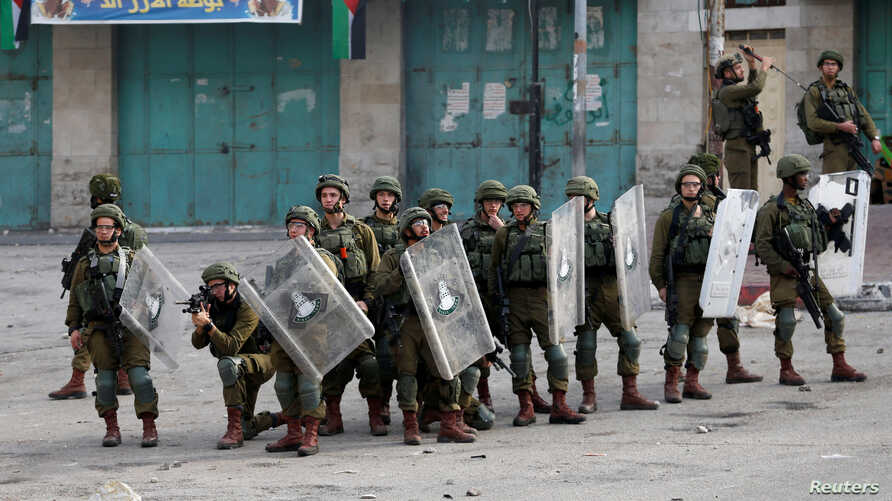 Israel soldiers take position during a Palestinian protest against the U.S. president Donald Trump's Middle East peace plan, in…