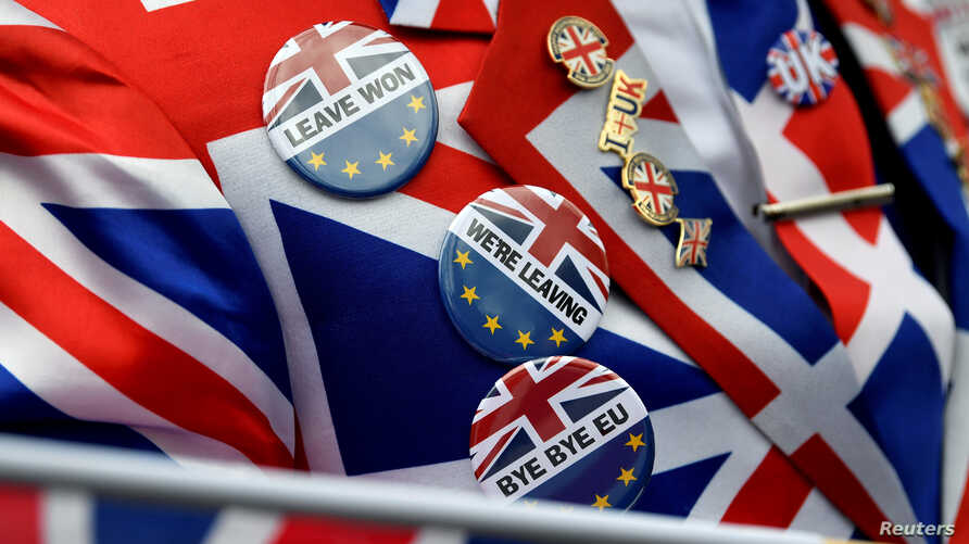 Pro-Brexit pins are seen on supporter's jacket at Parliament Square, on Brexit day in London, Britain January 31, 2020. REUTERS…