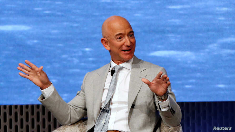 FILE PHOTO: Jeff Bezos, founder of Amazon and Blue Origin speaks  during the JFK Space Summit, celebrating the 50th anniversary…