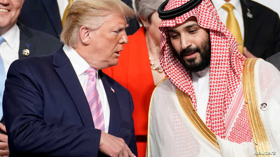 FILE PHOTO: U.S. President Donald Trump speaks with Saudi Arabia's Crown Prince Mohammed bin Salman during a photo session with…