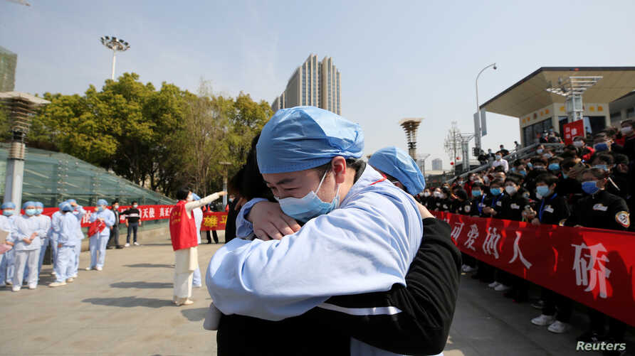 A local medical worker embraces and bids farewell to a medical worker from Jiangsu at the Wuhan Railway Station as the medical…
