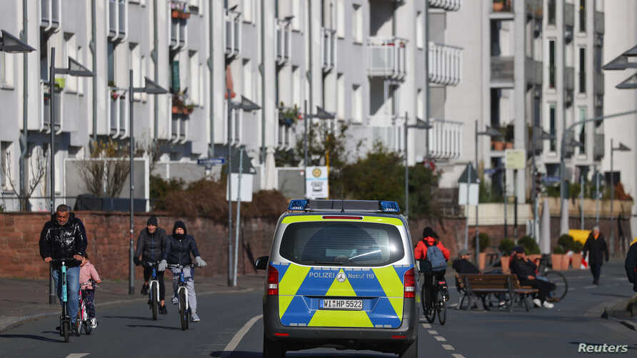 German police patrols on a street near the Main river during a partial lockdown in Frankfurt, Germany, March 23, 2020, as the…