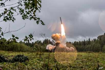 FILE - This undated file photo provided by Russian Defense Ministry official website Sept. 19, 2017, shows a Russian Iskander-K missile launched during a military exercise at a training ground at the Luzhsky Range, near St. Petersburg, Russia.