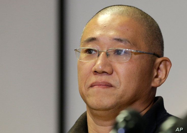 FILE - Kenneth Bae talks to reporters at Joint Base Lewis-McChord, Washington, Nov. 8, 2014.