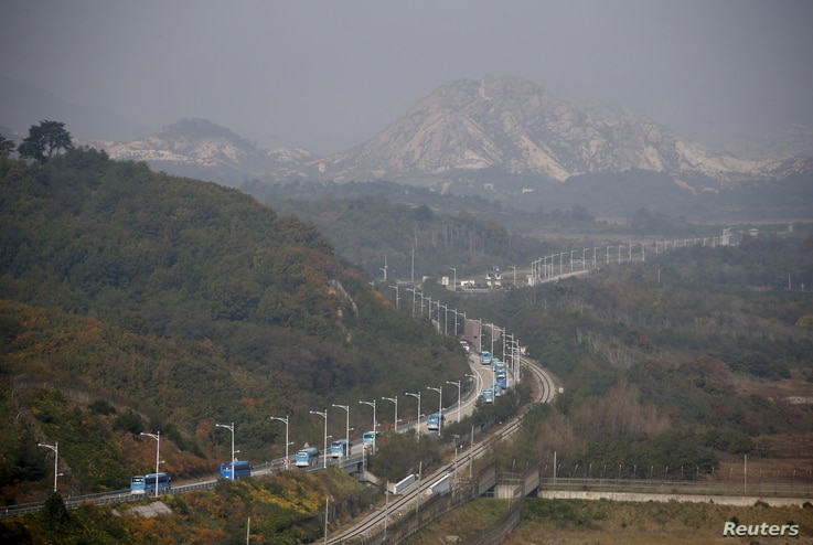 FILE - Buses transporting South Korean participants for a reunion travel on the road leading to North Korea's Mount Kumgang resort, in the demilitarized zone (DMZ) separating the two Koreas, just south of the DMZ in Goseong, South Korea, Oct. 20, 2015.