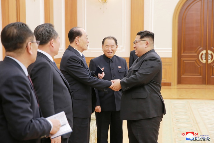 North Korean leader Kim Jong Un meets members of the high-level delegation of the Democratic People's Republic of Korea, which visited South Korea to attend the opening ceremony of the 23rd Winter Olympics in this undated photo released by North Korea'...