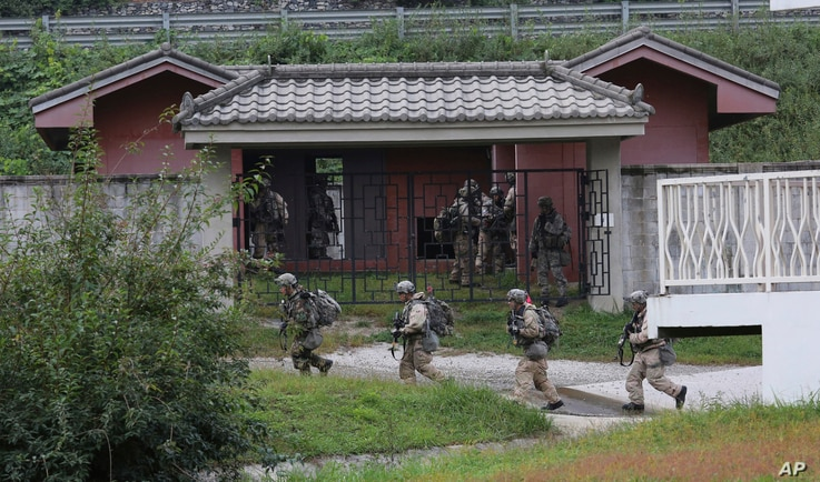FILE - In this Sept. 19, 2017, photo, U.S. Army soldiers from the 2nd Infantry Division's 2nd Armored Brigade Combat Team move during a joint military exercise between the U.S. and South Korea in Pocheon, South Korea. A South Korean lawmaker said Oct. ...