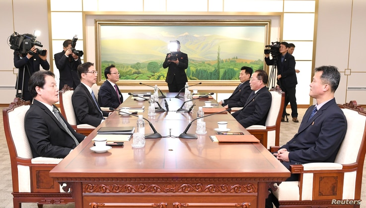 Head of the North Korean delegation Jon Jong Su talks with his South Korean counterpart Chun Hae-sung during their meeting at the truce village of Panmunjom in the demilitarized zone separating the two Koreas, South Korea, Jan. 17, 2018.