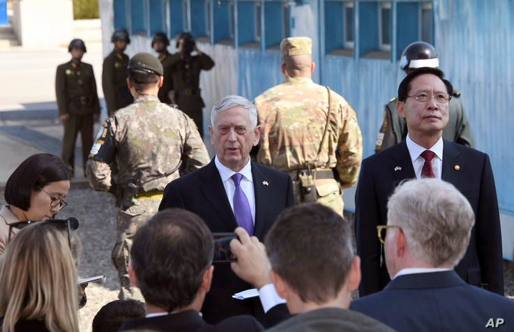 FILE - U.S. Defense Secretary Jim Mattis, center, speaks to the media as South Korean Defense Minister Song Young-moo, right, looks on during a visit to the truce village of Panmunjom in the Demilitarized Zone (DMZ), Oct. 27, 2017.
