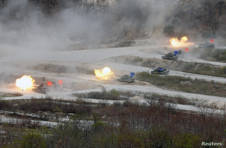 FILE - South Korean Army K1A1 and U.S. Army M1A2 tanks fire live rounds during a U.S.-South Korea joint live-fire military exercise, at a training field near the demilitarized zone separating the two Koreas in Pocheon, South Korea, April 21, 2017.