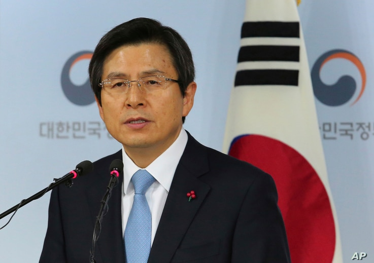 FILE - Acting South Korean President Hwang Kyo-ahn speaks during a press conference at the government complex in Seoul, South Korea, Dec. 9, 2016.