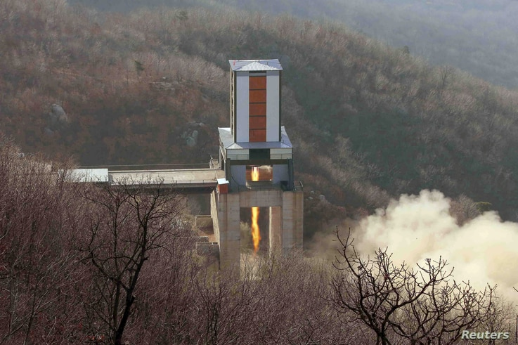 FILE - A new engine for an intercontinental ballistic missile (ICBM) is tested at a test site at Sohae Space Center in Cholsan County, North Pyongan province, in North Korea in this undated photo released by North Korea's Korean Central News Agency (KC...