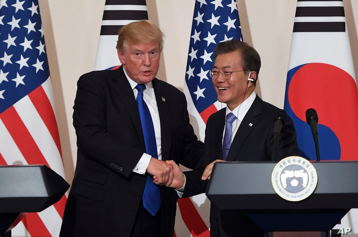 FILE - U.S. President Donald Trump, left, and South Korean President Moon Jae-in shake hands during a joint press conference at the presidential Blue House in Seoul, South Korea, Nov. 7, 2017.