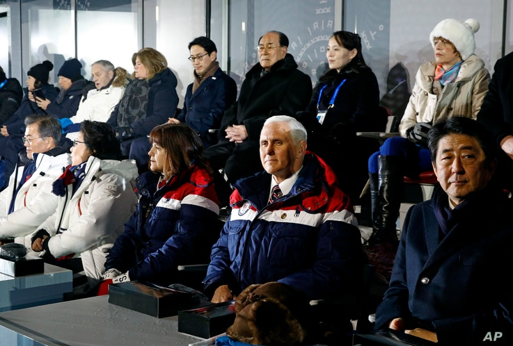 Vice President Mike Pence, second from bottom right, sits between second lady Karen Pence, third from from bottom left, and Japanese Prime Minister Shinzo Abe at the opening ceremony of the 2018 Winter Olympics in Pyeongchang, South Korea, Feb. 9, 2018.