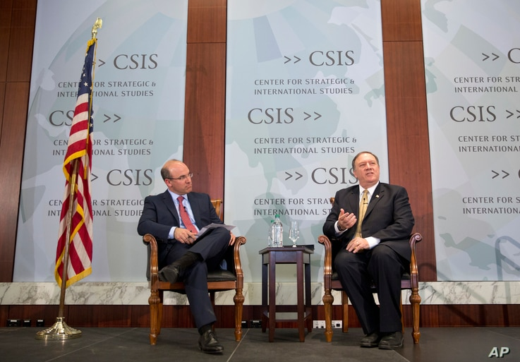 CIA Director Mike Pompeo, right, answers question while speaking at the Center for Strategic and International Studies In Washington, April 13, 2017. Also on stage is Juan Zarate, senior adviser at CSIS.