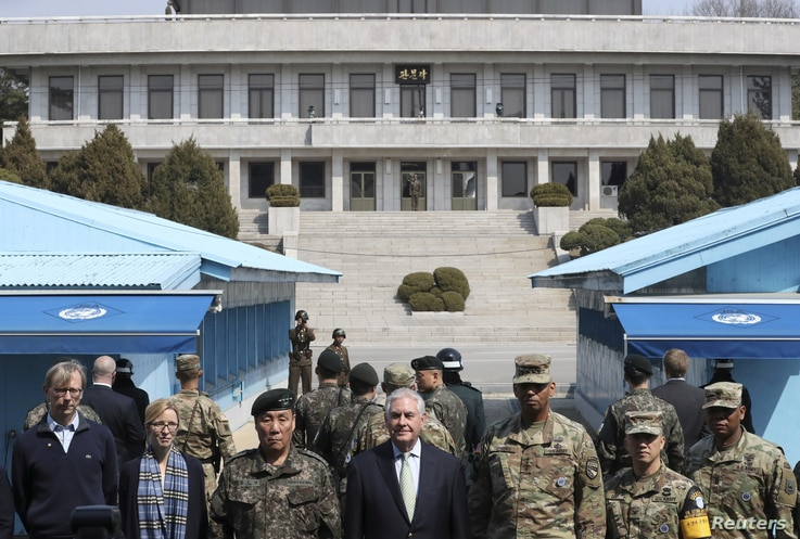 U.S. Secretary of State Rex Tillerson (center) stands with U.S. Gen. Vincent K. Brooks (third right) commander of the United Nations Command, Combined Forces Command and United States Forces Korea, and South Korean Deputy Commander of the Combined Forc...