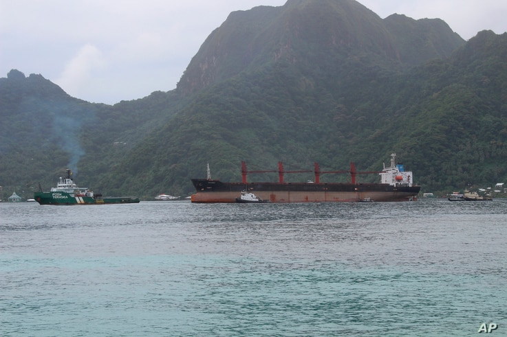 FILE - The North Korean cargo ship, Wise Honest, middle, was towed into the Port of Pago Pago, May 11, 2019, in Pago Pago, American Samoa.