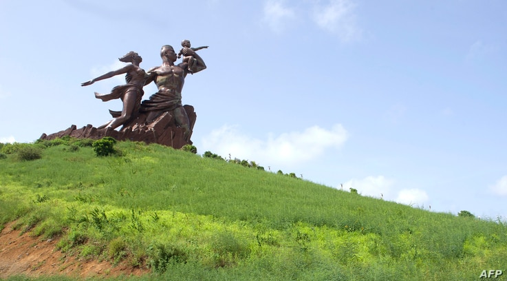 This photograph taken on September 27, 2017, shows The Monument of the African Renaissance which sits on a volcanic hill overlooking Dakar, the capital of Senegal.